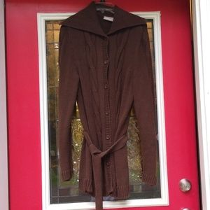Women's long cardigan button up sweater with tie.